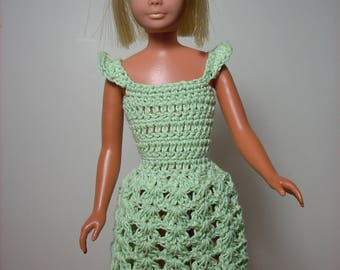 a cute little dress with ruffled sleeves done in mint green