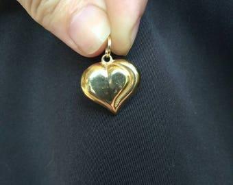 14k yellow gold puffy heart pendant.