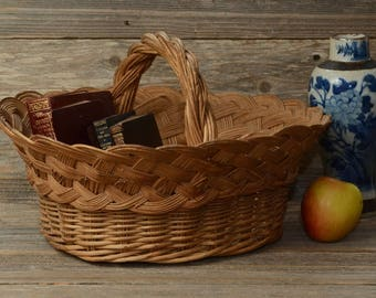 LARGE VINTAGE BASKET--A Large Old Wicker Basket With a Large, Stout Handle