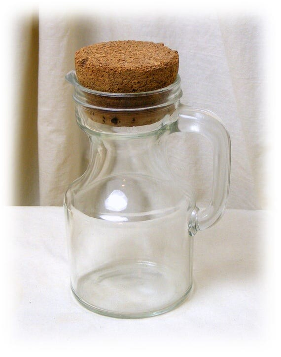 CUTE GLASS PITCHER . . with cork top