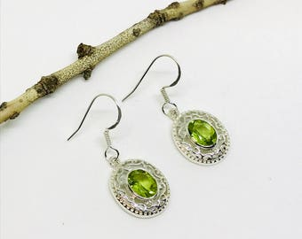 Peridot earrings set in sterling silver (92.5). Genuine natural faceted peridot stones. Perfectly matched stones.