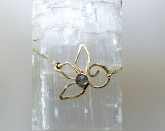 Circle of life Lotus with a wrapped labradorite coin