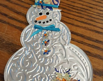 Snowman made from Peach-Pear La Croix can