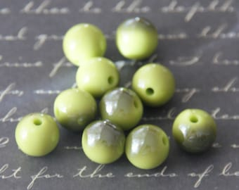 10 olive green and iridescent beads