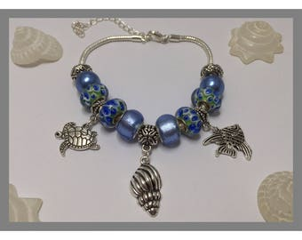 Blue charm's bracelet with different charms, holiday ref 544 series