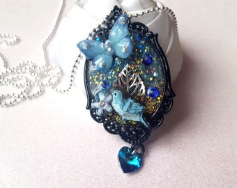 pendant necklace, bird and butterfly and her Galaxy fairy