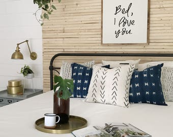 Bed, I love you. Wooden sign