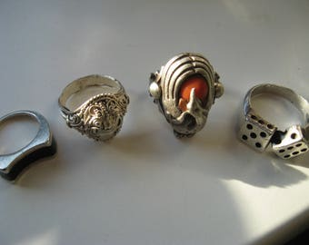 three silver rings one other ring with stone silver vintage
