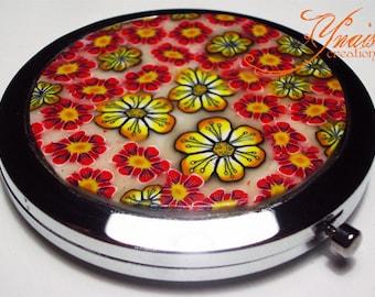 round Pocket mirror has clay flowers