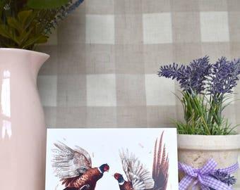 Fighting pheasants greeting card