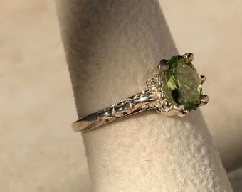 50 percent off of list price if over 50.00.Silver Filigree Ring Peridot Apple green like this piece is desired color!