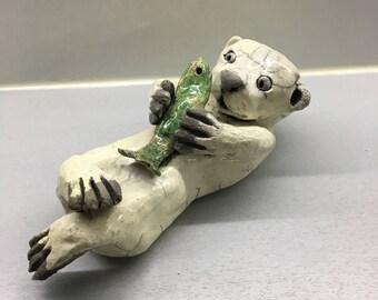 Ceramic raku baby otter