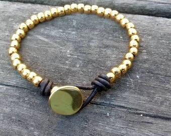 One 50 style bracelet, gold bracelet
