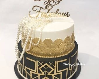 80th Birthday cake topper reads: Eighty & Fabulous