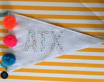 ATX pennant with pom poms