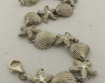 "Sterling Silver Star Fish & Shell Charm 7.5"" Bracelet."