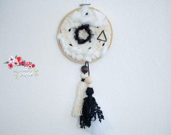 Black and white circular weaving and pompons