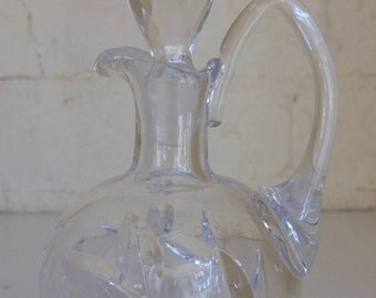 Delicate cut glass bottle with handle and stopper