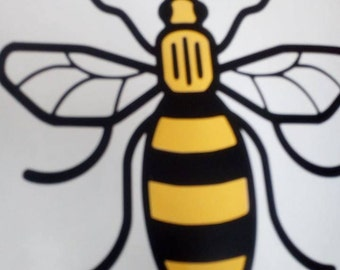 Manchester bee vinyl sticker with yellow stripes for walls, furniture, cars, windows etc in support of the we love Manchester fund
