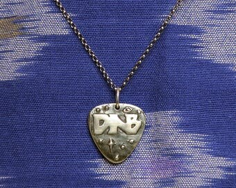 Silver DNB in space pendant