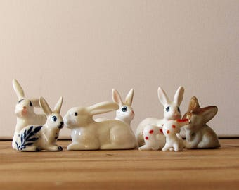 vintage bone china rabbit collection - 6 miniature ceramic white bunnies and a pair of glass ones