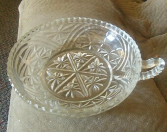 Vintage Shallow glass candy pickle relish dish  with thumb handle   sawtooth cut