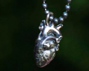 LHR jewelry sterling silver anatomical heart pendant.