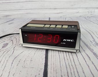 Vintage Small KMC Wood Panel Alarm Clock Radio Faux Wood Grain FM/AM Dual Bedside Electronic Digital Display Hong Kong