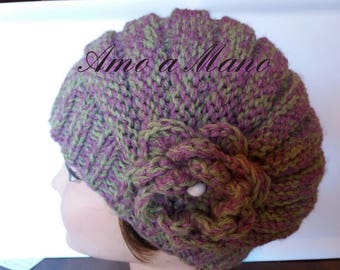 Hand-made knitted hat in soft wool blend with flower and wooden bead