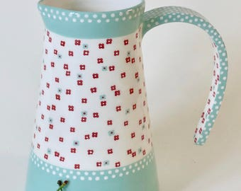 Turquoise pitcher and flowers - ceramic water jug