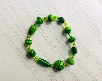 Green striped bracelet with glass beads