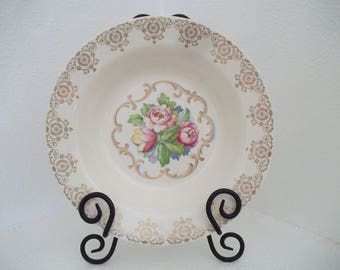 Beautiful vintage serving bowl made by Royal China  Inc. Sebring Ohio.  Warranted 22k gold scroll border with gold filigree floral center.