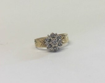 18ct Gold Flower Design Diamond Ring With Shoulder Design