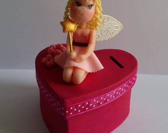 Piggy bank with little fairy of cold porcelain