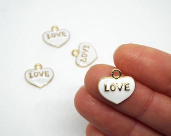 2x Small Heart 'LOVE' Enamel Charm 14mm x 14mm. Ivory enamel set on a gold tone heart