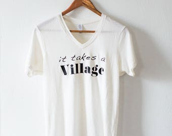 The Original 'It Takes a Village®' Tee, by The Village Magazine, Made in USA