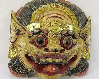 Old wooden mask from Indonesia used for rituals, with Gold details