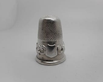 English silver thimble with applied band. c 1860