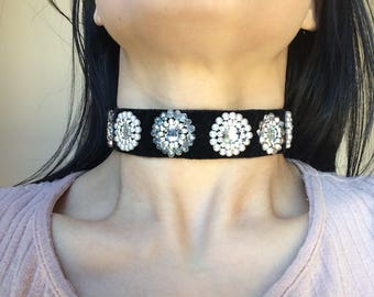 Black choker with shiny centre gems with light purple, silver, light pink and clear beads.