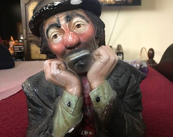 Clown statue unique and homeless looking