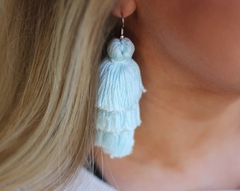 Light Blue Tiered Lightweight Tassel Earrings by TheCourtCo