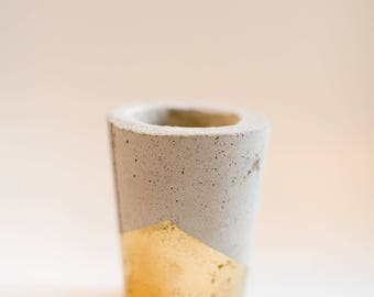 Concrete candle holder with gold accents
