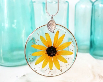 Necklace with yellow flower preserved in resin
