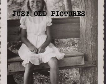 Cute young blonde girl sitting on bench old vintage photo/snapshot/photograph-e133