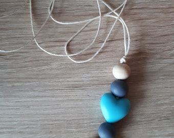 Blue heart necklace for breast feeding mom