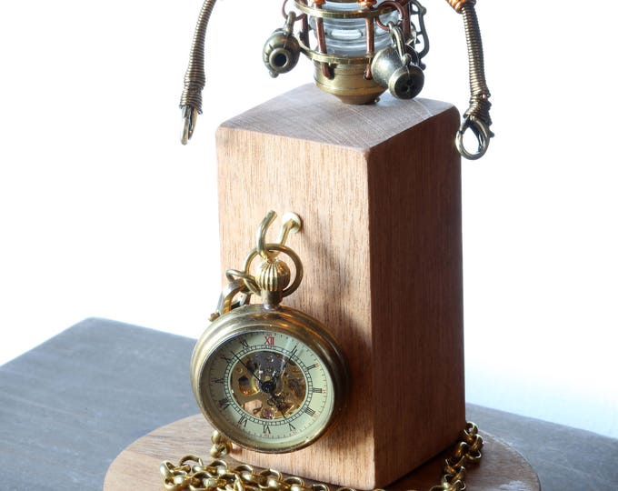 Steampunk Robot Minion Sculpture with tea cup and teapot in a glass dome display including a small pocket watch