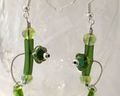 Lauren, spring green glass dangle earrings, on guitar strings, green tulips, leaves  sculptural,  handmade, contemporary. steampunk