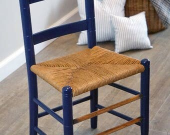 Antique child's ladder back chair with hand woven rush seat and hand made french ticking cushions, restored antique, navy blue