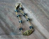 15 and Blue Bracelet - antiqued brass scrapbook element, dark blue Chinese crystals, simple bead chain link bracelet