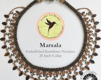 Marsala Is A 20 Inch Embellished Kumihimo Bib Necklace, Metallic Brown Iris Seed Beads With Rose Gold Picasso Beads And Dark Topaz Leaves